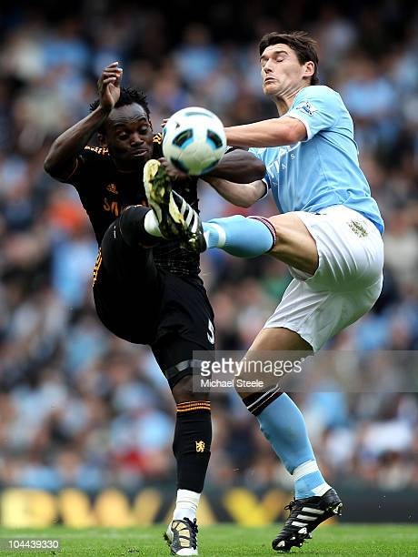 Gareth Barry of Manchester City competes for the ball with Michael Essien of Chelsea during the Barclays Premier League match between Manchester City...