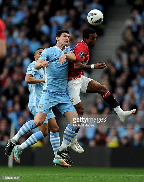 Gareth Barry of Manchester City competes in the air with Nani of Manchester United during the Barclays Premier League match between Manchester City...