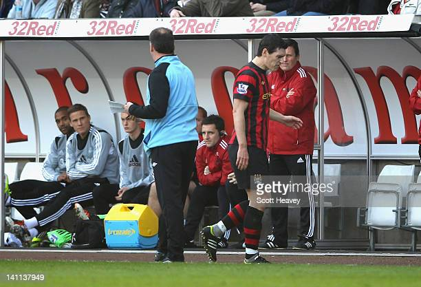 Gareth Barry of Manchester City is angry about being substitued and has words with assistant manager David Platt during the Barclays Premier League...
