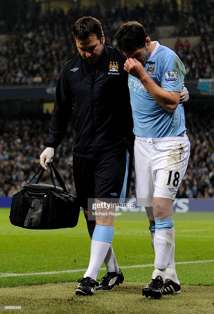 Gareth Barry of Manchester City is helped from the pitch with an injury during the Barclays Premier League match between Manchester City and Tottenham Hotspur at the City of Manchester Stadium on May 5, 2010 in Manchester, England.
