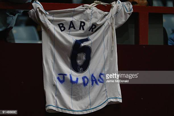 Gareth Barry of Manchester City is welcomed back to Villa Park with a message on a replica shirt during the Barclays Premier League match between...