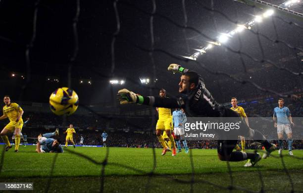 Gareth Barry of Manchester City scores a header past Adam Federici of Reading during the Barclays Premier League match between Manchester City and...