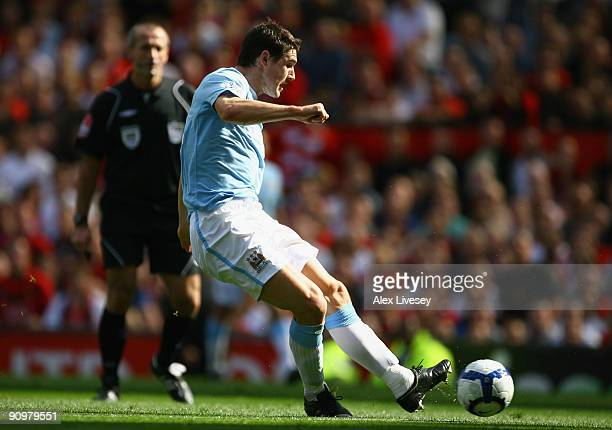 Gareth Barry of Manchester City scores his team's first goal during the Barclays Premier League match between Manchester United and Manchester City...