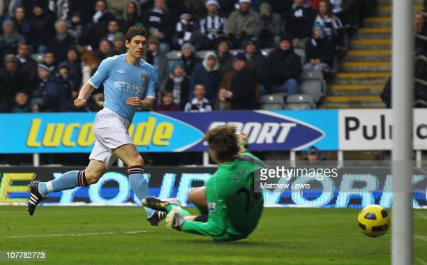 Gareth Barry of Manchester City scores the opening goal past goalkeeper Tim Krul of Newcastle United during the Barclays Premier League match between...