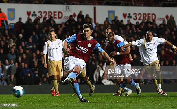 Gareth Barry of Villa scores the equaliser from the penalty spot during the Barclays Premier League match between Aston Villa and Middlesbrough at...