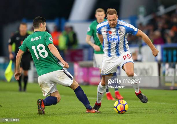 Gareth Barry of West Bromwich Albion and Laurent Depoitre of Huddersfield Town in acton during the Premier League match between Huddersfield Town and...