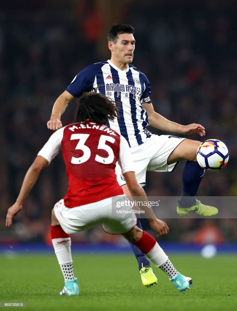 Gareth Barry of West Bromwich Albion is faced by Mohamed Elneny of Arsenal during the Premier League match between Arsenal and West Bromwich Albion at Emirates Stadium on September 25, 2017 in London, England. Gareth Barry is making a record 633rd Premier League appearance.