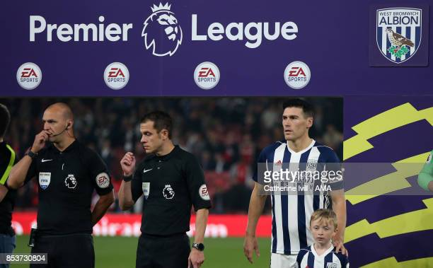 Gareth Barry of West Bromwich Albion lines up for his record breaking appearance under the Premier League logo before the Premier League match...