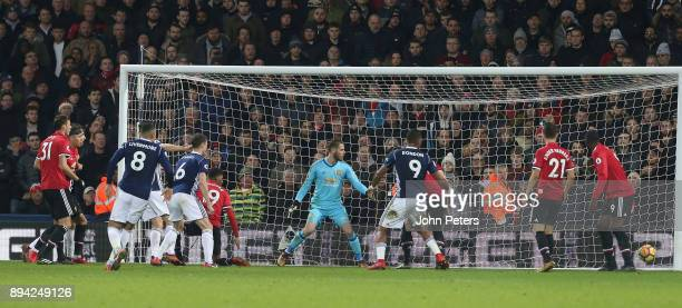 Gareth Barry of West Bromwich Albion scores their first goal during the Premier League match between West Bromwich Albion and Manchester United at...