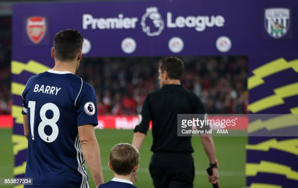 Gareth Barry of West Bromwich Albion walks out on the pitch past the Premier League logo to break the record for appearances before the Premier...