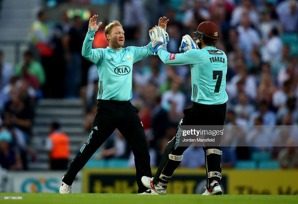 Gareth Batty and Ben Foakes of Surrey celebrates dismissing Ravi Bopara of Essex during the Vitality Blast match between Surrey and Essex Eagles at The Kia Oval on July 12, 2018 in London, England.