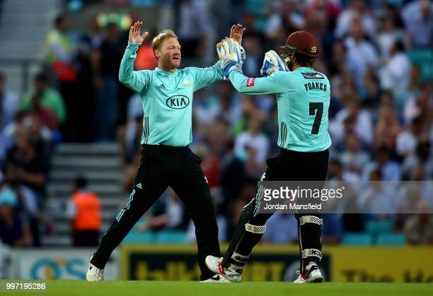 Gareth Batty and Ben Foakes of Surrey celebrates dismissing Ravi Bopara of Essex during the Vitality Blast match between Surrey and Essex Eagles at...
