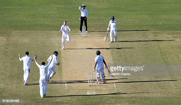 Gareth Batty of England celebrates dismissing Tamin Iqbal of Bangladesh during day two of the first Test between Bangladesh and England at Zohur...