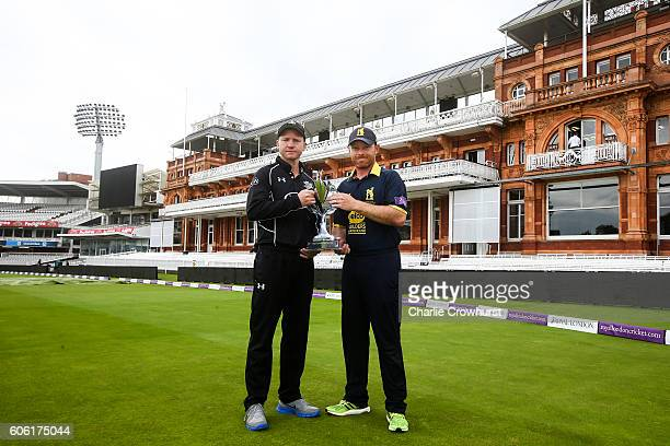 Gareth Batty of Surrey and Ian Bell of Warwickshire both pose with the Royal London One Day Cup trophy in front of the Pavillion during the Royal...