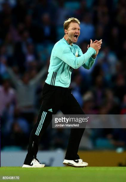 Gareth Batty of Surrey celebrates dismissing Eoin Morgan of Middlesex during the NatWest T20 Blast Surrey and Middlesex at The Kia Oval on July 21,...