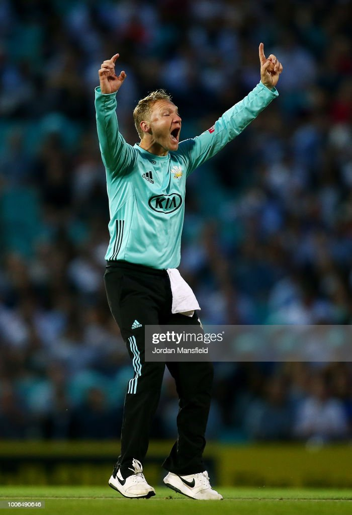 Gareth Batty of Surrey celebrates dismissing James Hildreth of Somerset during the Vitality Blast match between Surrey and Somerset at The Kia Oval on July 27, 2018 in London, England.