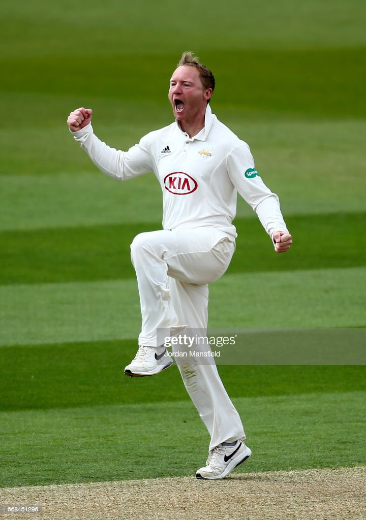Gareth Batty of Surrey celebrates getting the wicket of Ryan McLaren of Lancashire during day one of the Specsavers County Championship Division One match between Surrey and Lancashire at The Kia Oval on April 14, 2017 in London, England.