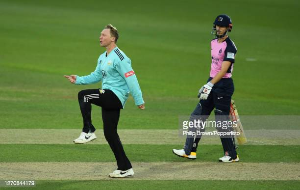 Gareth Batty of Surrey celebrates the dismissal of James Harris of Middlesex as John Simpson looks on during the Vitality T20 Blast match at The Kia...