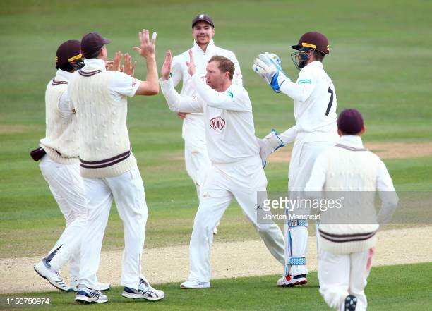 Gareth Batty of Surrey celebrates with his teammates after dismissing Daniel BellDrummond of Kent during day two of the Specsavers County...