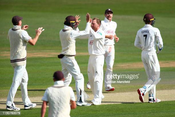 Gareth Batty of Surrey celebrates with his teammates after dismissing Heino Kuhn of Kent during day two of the Specsavers County Championship...
