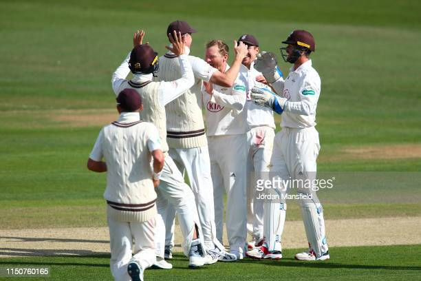 Gareth Batty of Surrey celebrates with his teammates after dismissing Ollie Robinson of Kent during day two of the Specsavers County Championship...