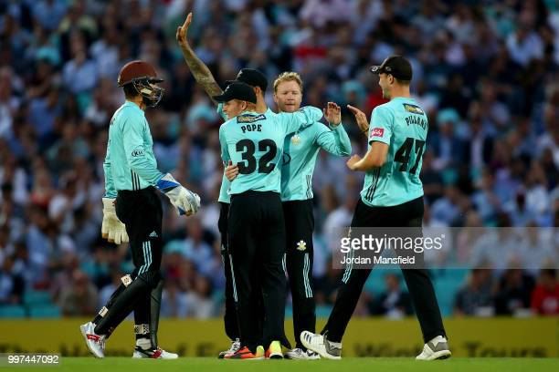 Gareth Batty of Surrey celebrates with his teammates after dismissing Ryan ten Doeschate of Essex during the Vitality Blast match between Surrey and...