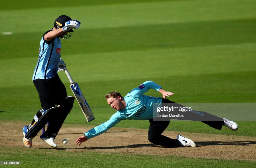 Gareth Batty of Surrey dives for a ball past Laurie Evans of Sussex during the NatWest T20 Blast match between Surrey and Sussex Shark at The Kia Oval on August 13, 2017 in London, England.