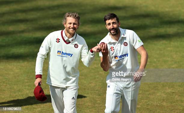 Gareth Berg and Ben Sanderson of Northamptonshire who both took five wickets celebrate after bowling out Sussex for 106 during the LV=Insurance...