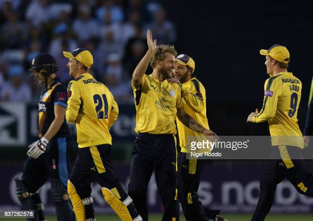 Gareth Berg of Hampshire celebrates with teamates after taking the wicket of Matt Critchley of Derbyshire Falcons during the NatWest T20 Blast at The...