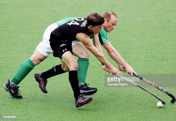 Gareth Brooks of New Zealand competes with Patrick Brown of Ireland during the Olympic Qualifying Hockey match between New Zealand and Ireland at...