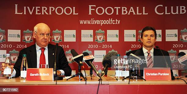 Gareth Bullock Group Executive Director of Standard Chartered and Christian Purslow Managing Director of Liverpool FC attend a press conference to...
