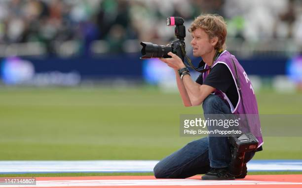 Gareth Copley, a photographer with Getty Images working for IDI in action before the ICC Cricket World Cup Group Match between West Indies and...