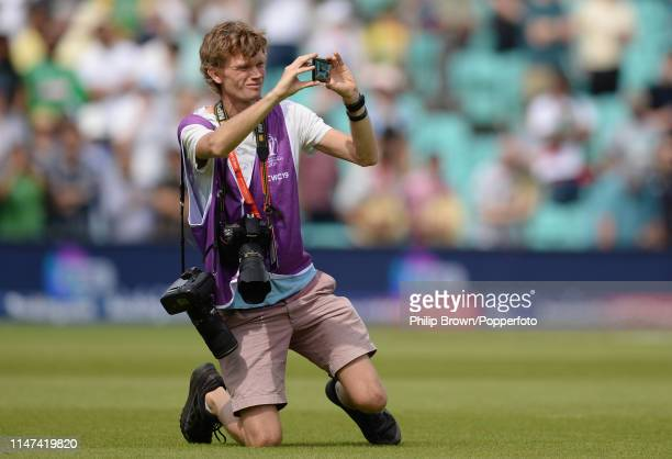 Gareth Copley a photographer with Getty Images working for the ICC takes a photo before the ICC Cricket World Cup Group Match between South Africa...
