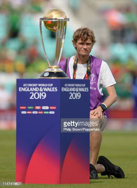 Gareth Copley a photographer with Getty Images working for the ICC behind the trophy before the ICC Cricket World Cup Group Match between South...