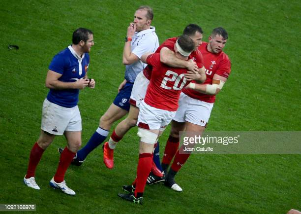 Gareth Davies Aaron Wainwright Elliot Dee celebrate the victory at final whistle from referee Wayne Barnes of England while Camille Lopez of France...