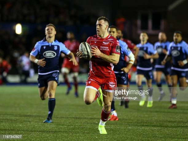 Gareth Davies intercepts to run in for a try during the Guinness Pro14 Round 10 match between Cardiff Blues and Scarlets at Cardiff Arms Park on...
