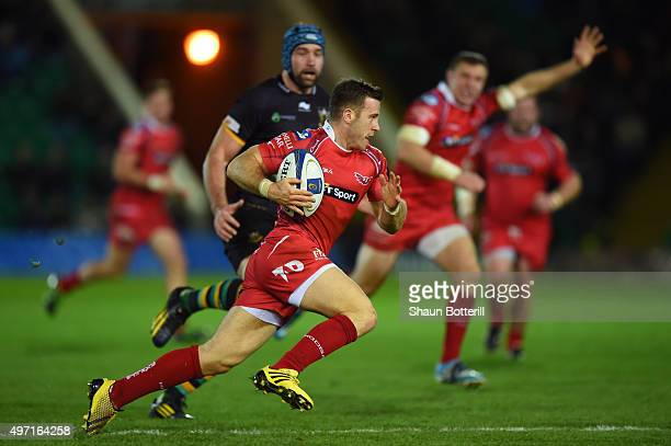 Gareth Davies of Scarlets cuts through the Northampton defence to score his team's opening try during the European Rugby Champions Cup Pool 3 match...