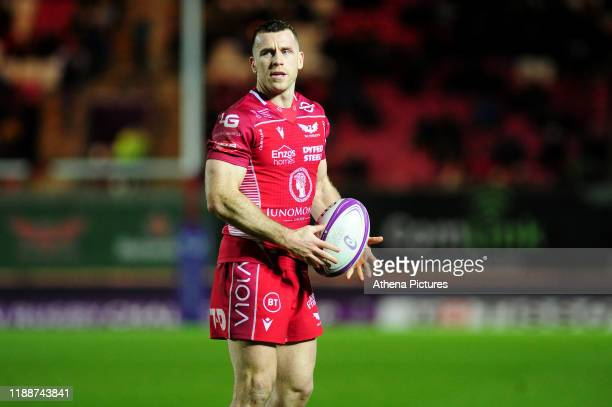 Gareth Davies of Scarlets in action during the European Rugby Challenge Cup Round 4 match between the Scarlets and Bayonne at the Parc Y Scarlets on...