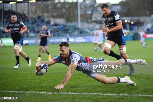 Gareth Davies of Scarlets scores the opening try during the Heineken Champions Cup Pool 1 match between Bath Rugby and Scarlets at The Recreation...