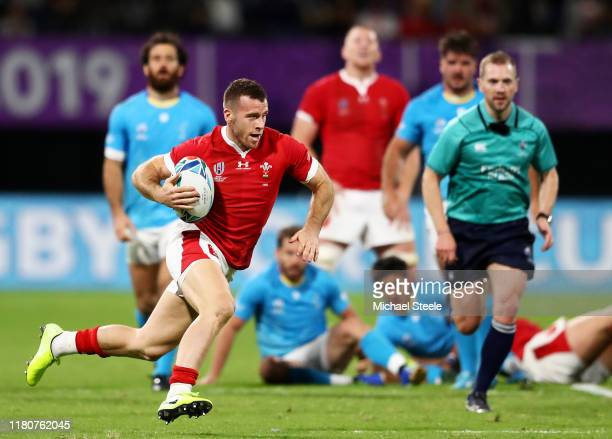 Gareth Davies of Wales breaks away to score his team's fifth try during the Rugby World Cup 2019 Group D game between Wales and Uruguay at Kumamoto...
