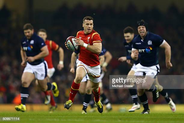 Gareth Davies of Wales breaks away to score the opening try during the RBS Six Nations match between Wales and Scotland at the Principality Stadium...