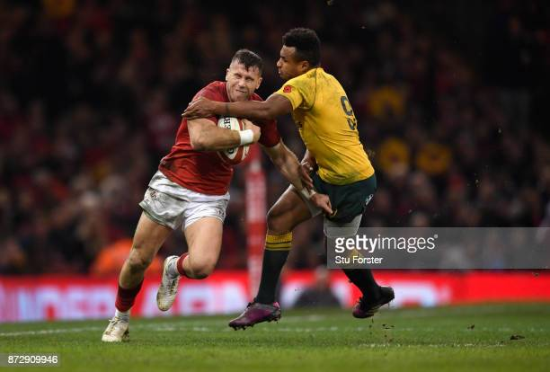 Gareth Davies of Wales breaks the tackle of Will Genia of Australia during the Under Armour Series match between Wales and Australia at Principality...