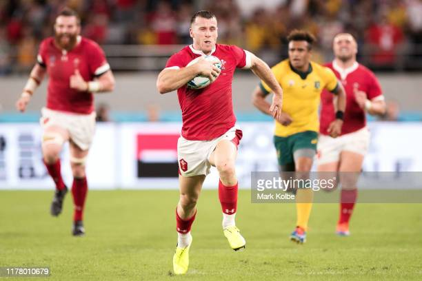Gareth Davies of Wales breaks through before going over to score his team's second try during the Rugby World Cup 2019 Group D game between Australia...