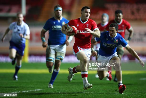 Gareth Davies of Wales breaks through to score their third try during the Autumn Nations Cup match between Wales and Italy at Parc y Scarlets on...