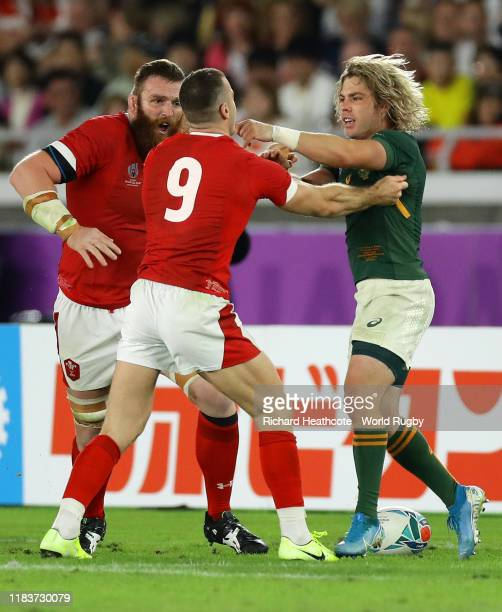Gareth Davies of Wales clashes with Faf de Klerk of South Africa during the Rugby World Cup 2019 SemiFinal match between Wales and South Africa at...