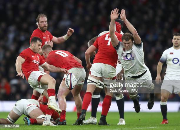 Gareth Davies of Wales clears the ball as Joe Launchbury of England attempts to charge down during the NatWest Six Nations round two match between...