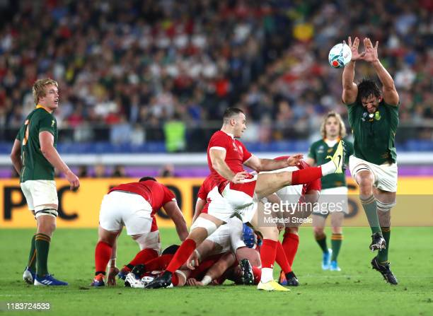 Gareth Davies of Wales clears the scrum ball defended by Lodewyk De Jager of South Africa during the Rugby World Cup 2019 SemiFinal match between...