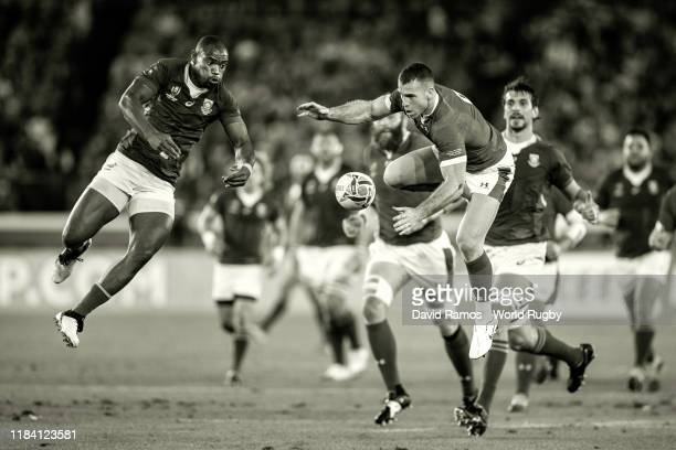 Gareth Davies of Wales goes for the high ball against Makazole Mapimpi of South Africa during the Rugby World Cup 2019 Semi-Final match between Wales...