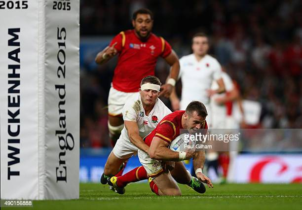 Gareth Davies of Wales goes over to score a try during the 2015 Rugby World Cup Pool A match between England and Wales at Twickenham Stadium on...