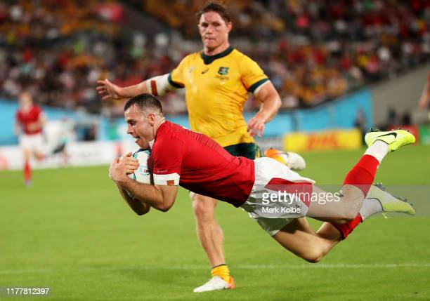 Gareth Davies of Wales goes over to score his team's second try during the Rugby World Cup 2019 Group D game between Australia and Wales at Tokyo...